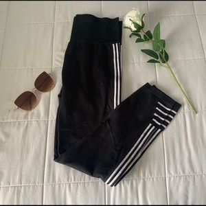 CHAMPION: black leggings with white strips